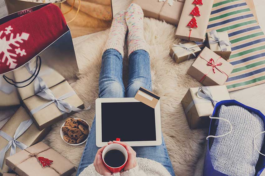 woman-makes-christmas-shopping-online-with-laptop